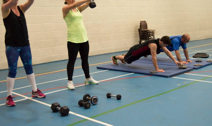 4 clients using gym equipment during a circuits class