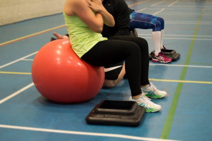 this is two clients using the balance balls in the sports hall for circuit classes.
