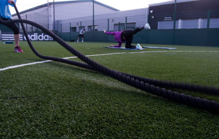 New body posture and battle ropes being used by clients during a TPTS Fitness Club circuits class.