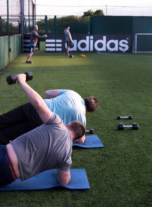 Clients perfecting their fitness techniques and weightloss during the Bootcamp class with TPTS Fitness Club