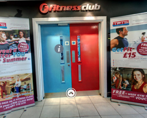 The front doorway and entrance into TPTS Fitness Club Swansea. Board at side stating you can get fit for as little as £15 a month